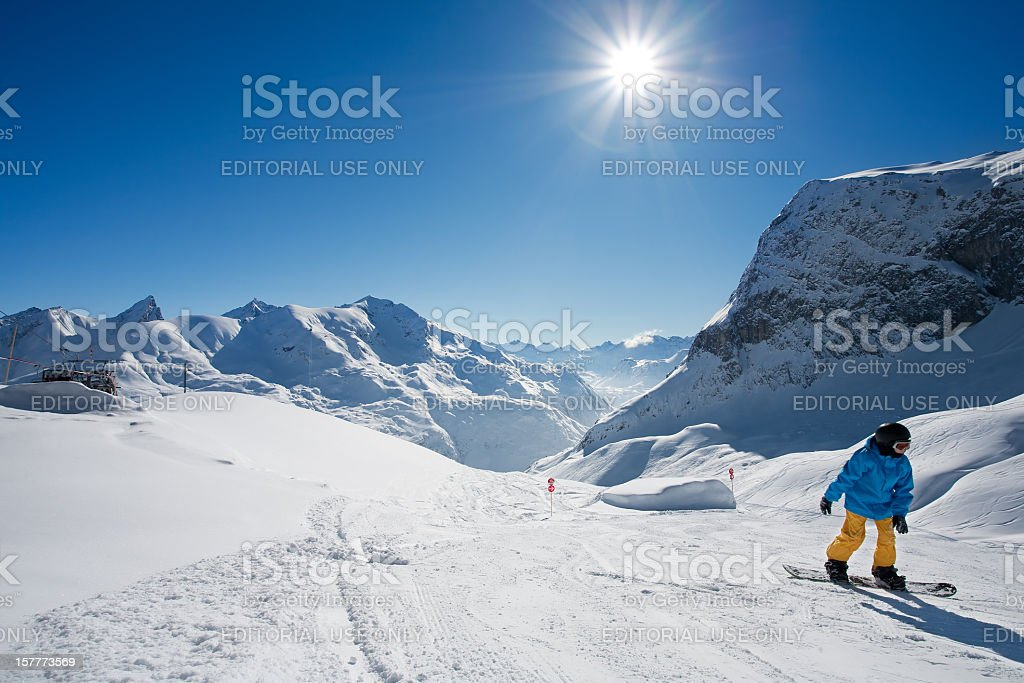 Snowboarder and mountain landscape stock photo