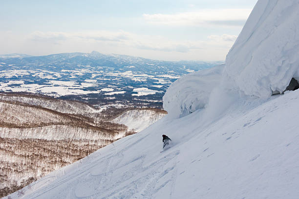 Snowboarder at a Ski Resort in Niseko, Hokkaido, Japan stock photo
