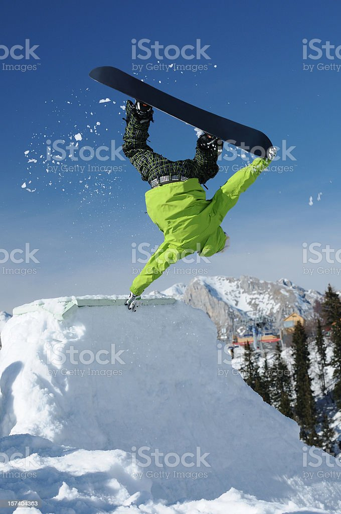 Snowboarder at handstand stock photo