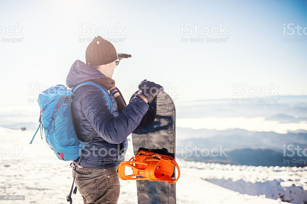 Snowboarder at the top of mountain stock photo
