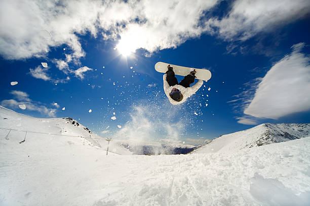 Snowboarder backflip stock photo