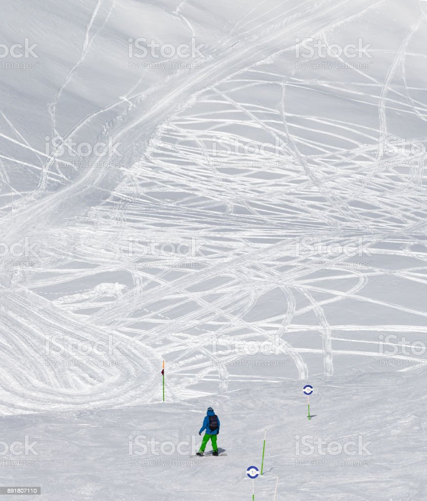 Snowboarder before downhill on freeriding trace at sun cold day stock photo