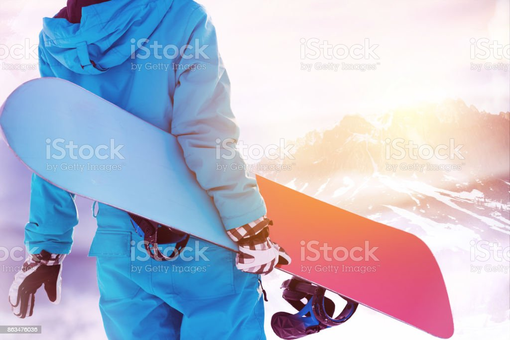 Snowboarder big mountains area ski resort stock photo
