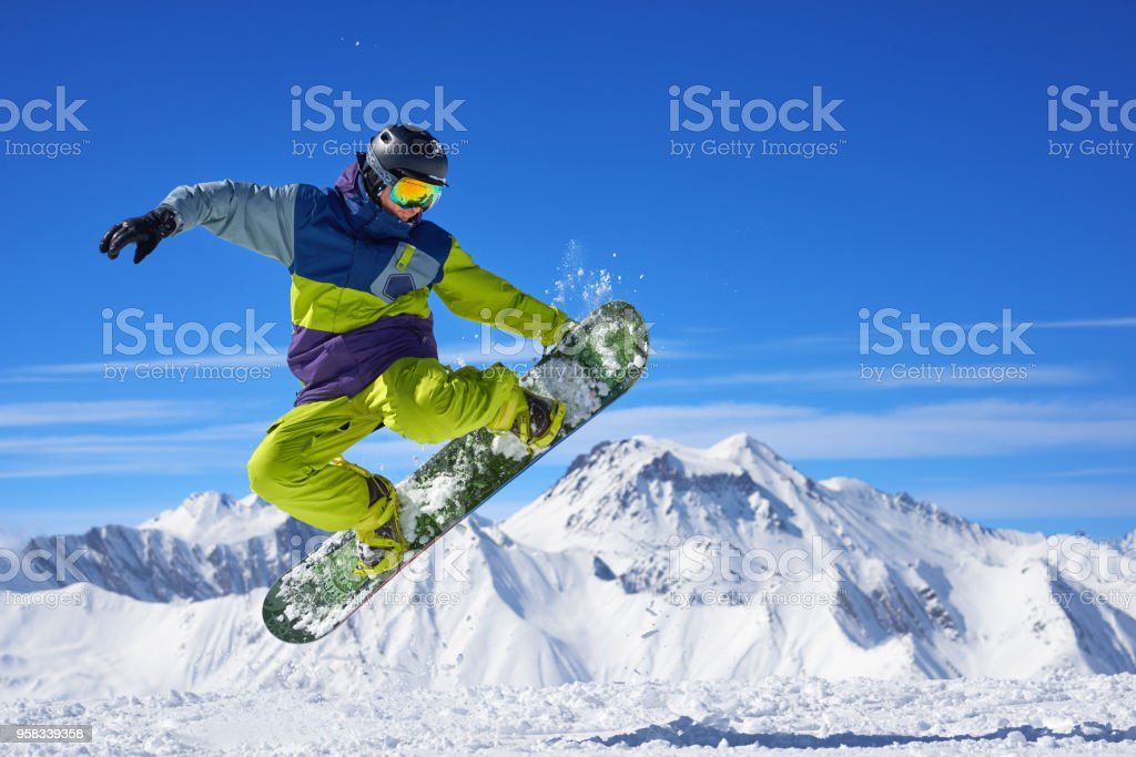 Snowboarder doing trick stock photo
