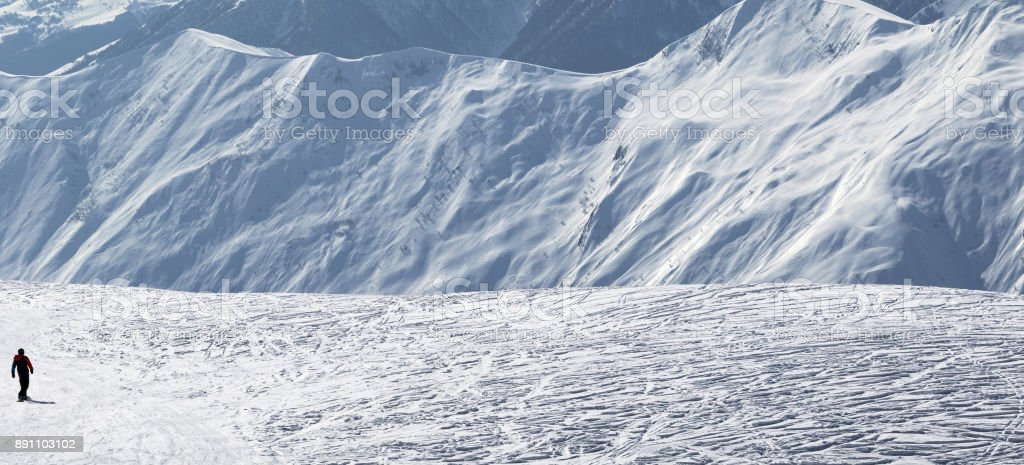 Snowboarder downhill on snow off-piste slope stock photo