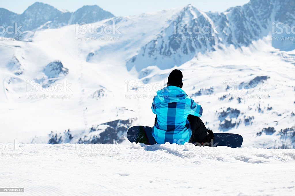 Snowboarder enjoying the nature in mountains stock photo