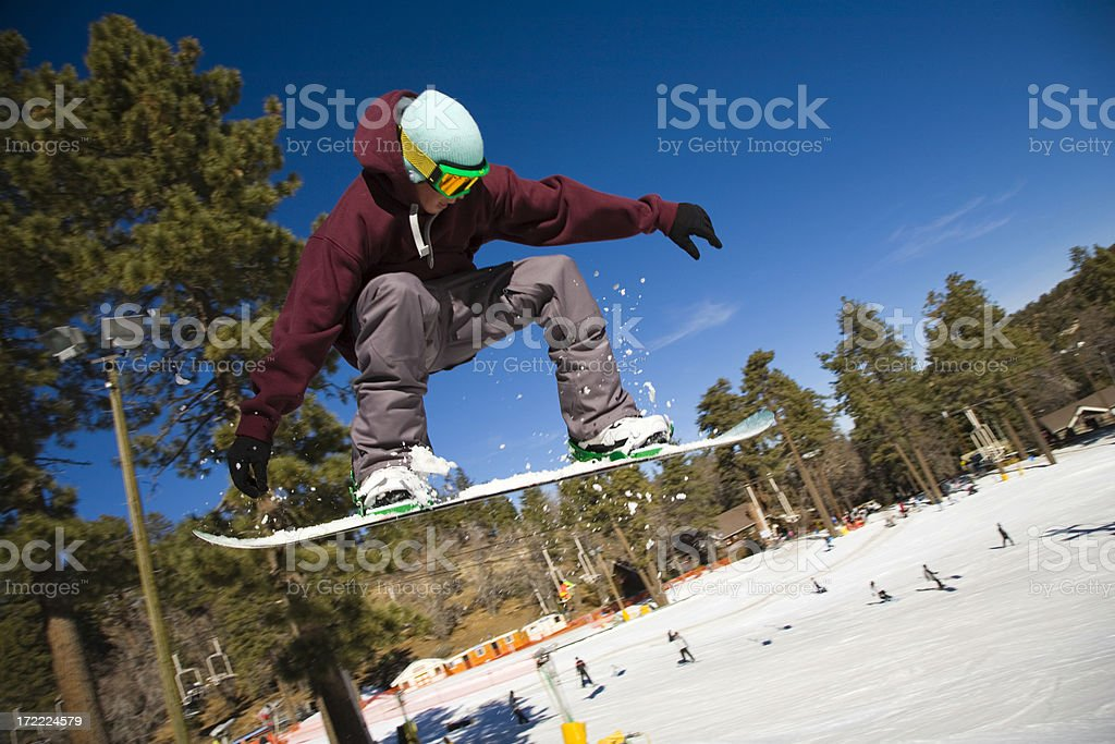 Snowboarder flies through the air royalty-free stock photo