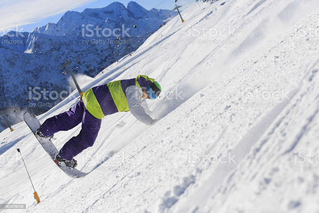 Snowboarder freestyle stunt on the mountain slope stock photo