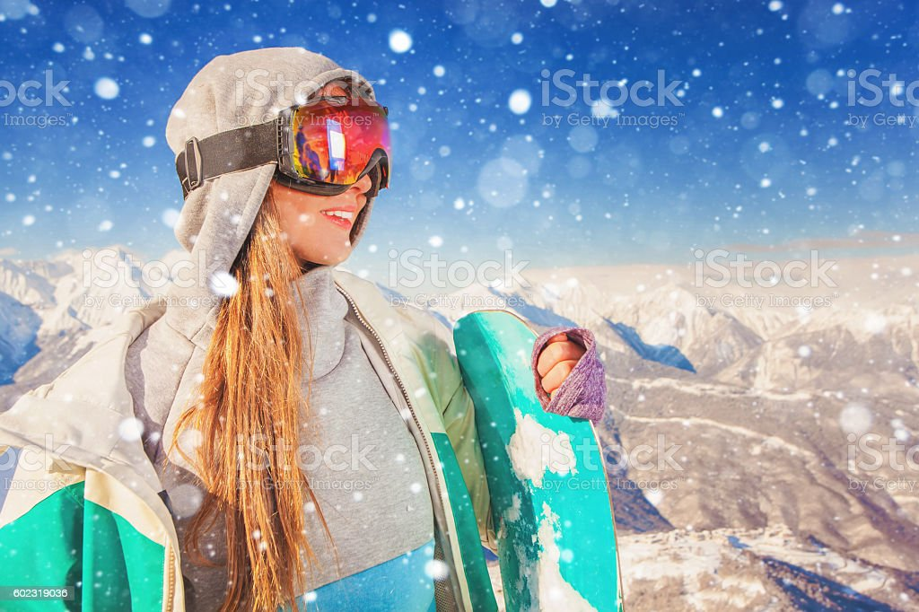 Snowboarder girl at Alps, Swiss mountain. Winter activities stock photo