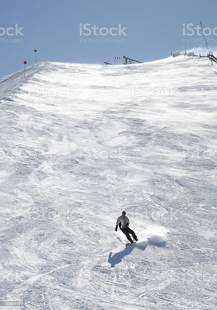 Snowboarder Going Down Hill stock photo