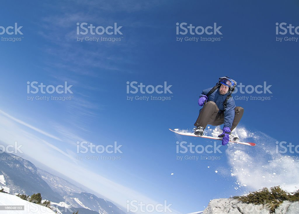 Snowboarder in Acrobatic Jump royalty-free stock photo