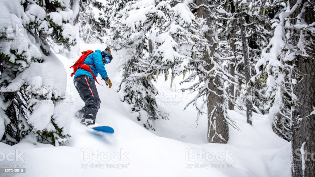Snowboarder in Action in Fresh Powder Snow stock photo