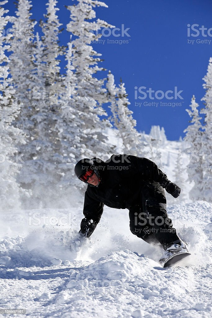 Snowboarder in action in Powder Snow royalty-free stock photo