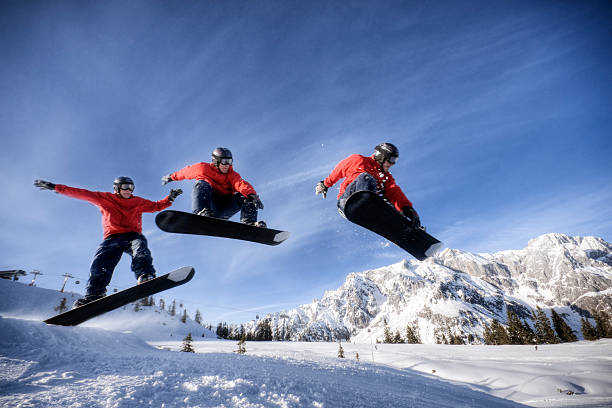 Snowboarder in Midair Snowboarder doing a shifty melon grab. sequential series stock pictures, royalty-free photos & images