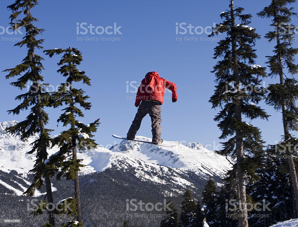Snowboarder In Red Coat stock photo