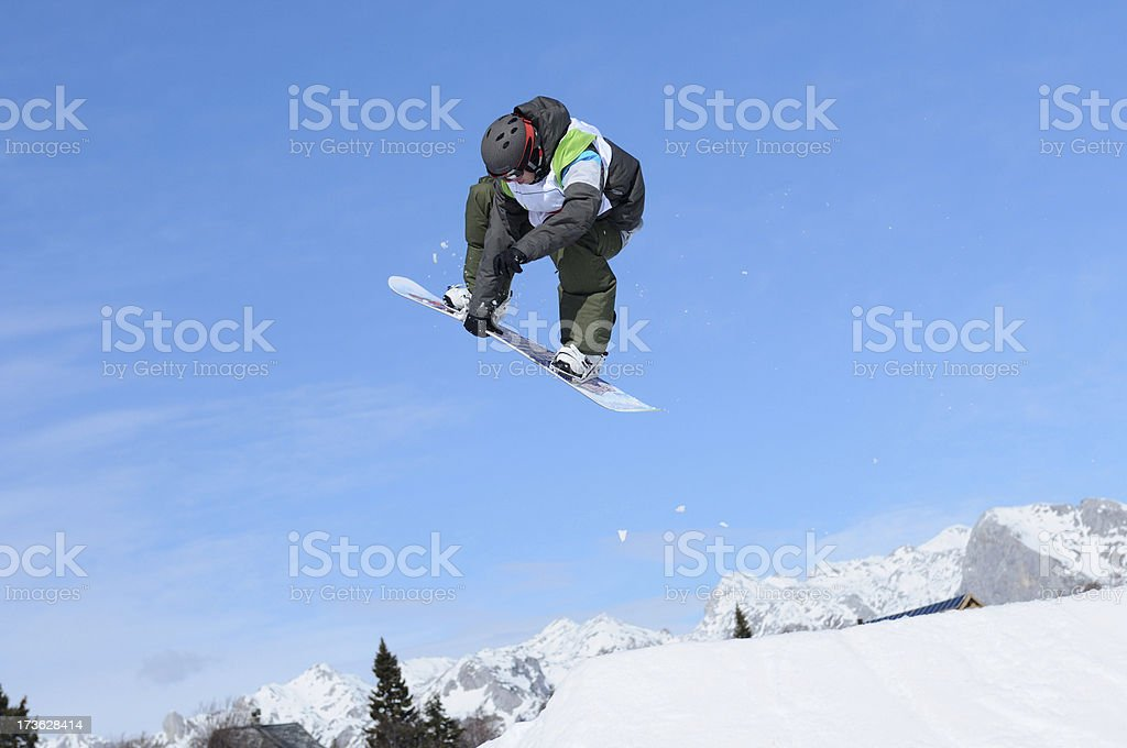 Snowboarder in the action stock photo