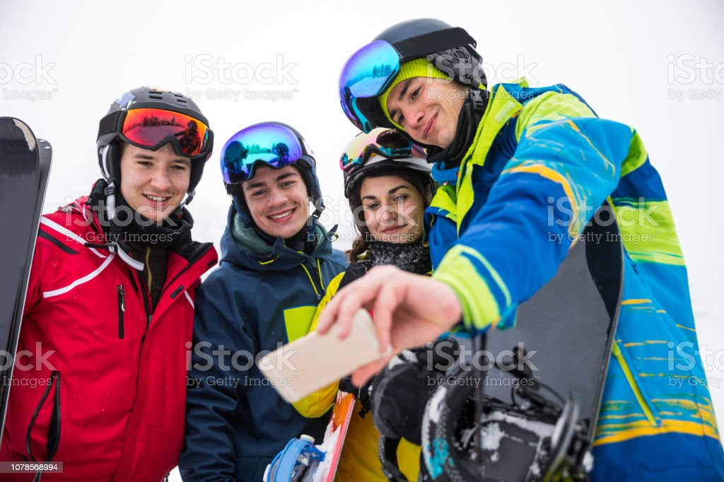 Snowboarder in the Alps - Group of friends having fun in a winter vacation stock photo