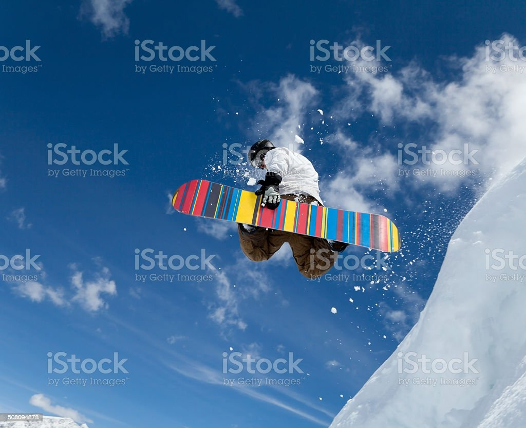 Snowboarder in the sky stock photo