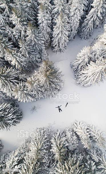Photo of Snowboarder in the snow