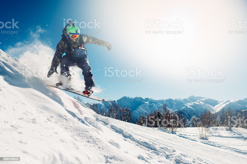 snowboarder is jumping with snowboard stock photo