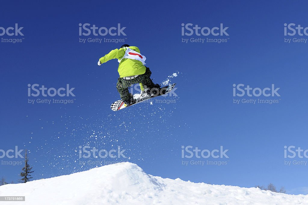 Snowboarder jump stock photo