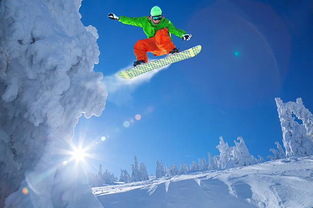 Snowboarder jumping against blue sky picture id598216382?b=1&k=6&m=598216382&s=612x612&w=0&h=b1zvujrfgbdbzzfqk1w40w9mgontel7jzcuplnmppra=