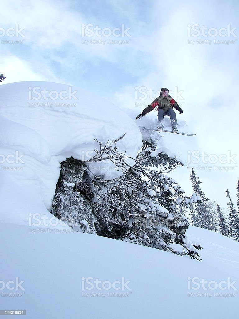 Snowboarder jumping high in the air royalty-free stock photo