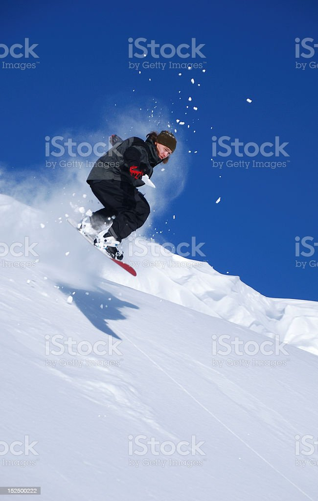 Snowboarder jumping high royalty-free stock photo