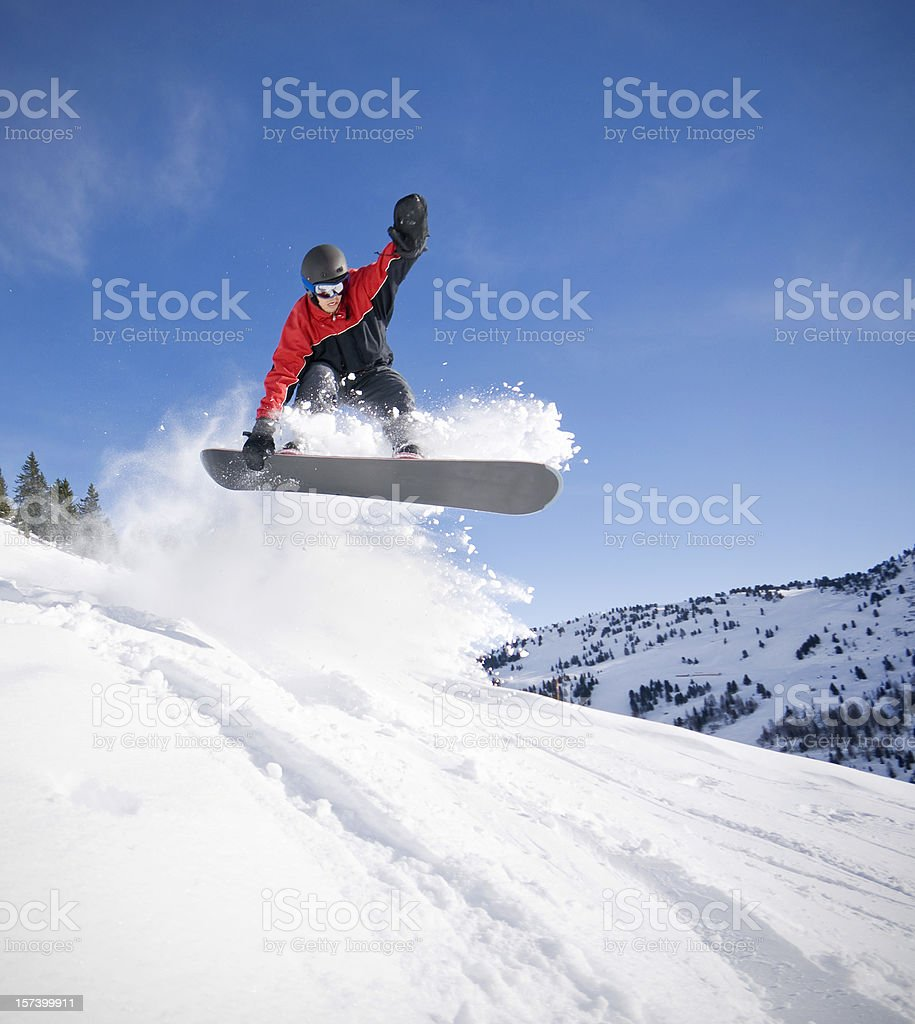Snowboarder Jumping in Deep Snow stock photo