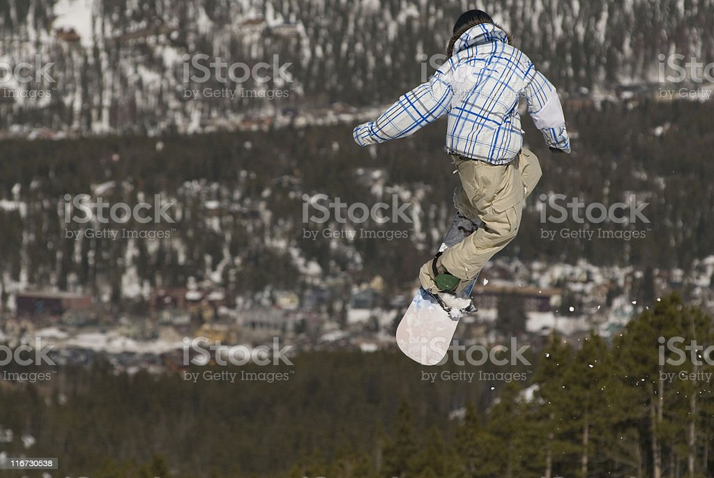 Snowboarder jumping stock photo