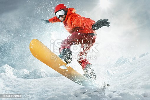 Snowboarder jumping through air with deep blue sky in background. The snowboard, snow, winter, extreme, snowboarding, sport concept