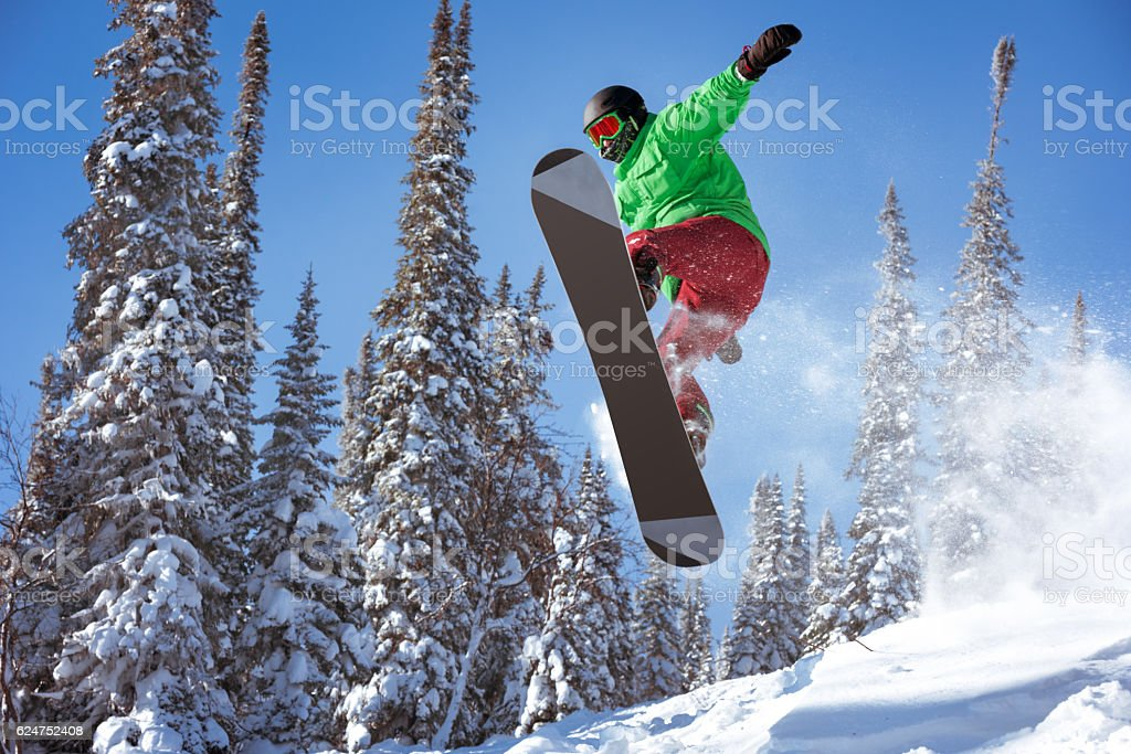 Snowboarder jumps freeride powder forest stock photo