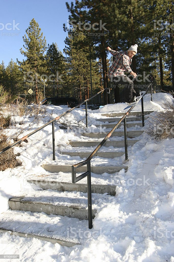 Snowboarder nosepress on handrail 2 stock photo