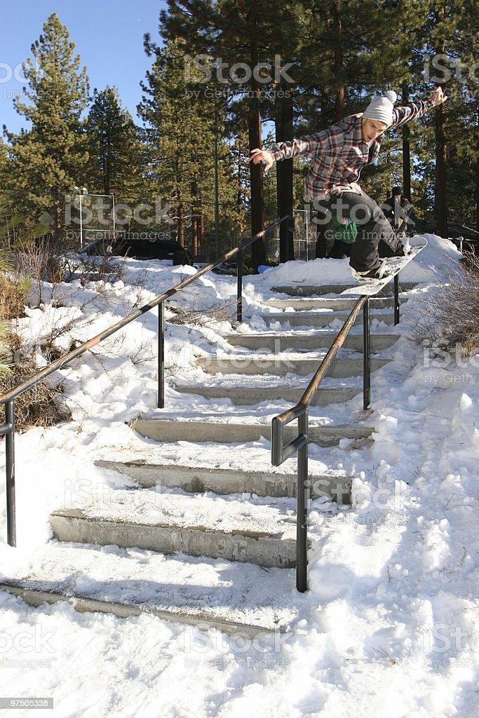 Snowboarder nosepress on handrail 3 royalty-free stock photo