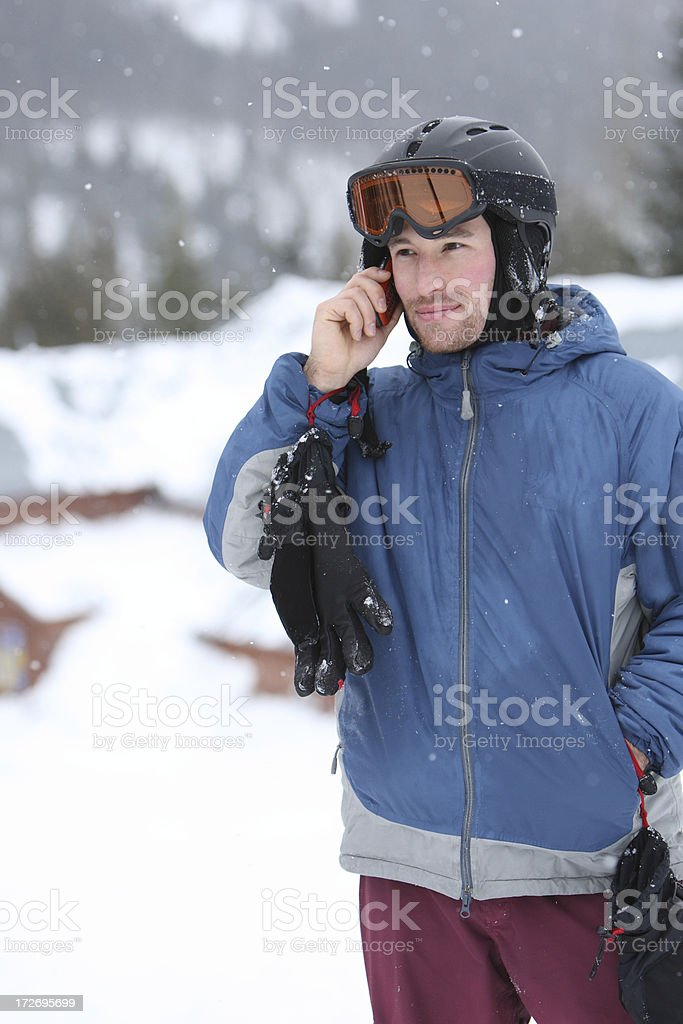 Snowboarder on cell phone royalty-free stock photo