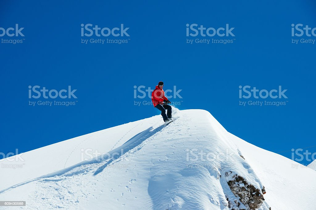 Snowboarder on the board stock photo