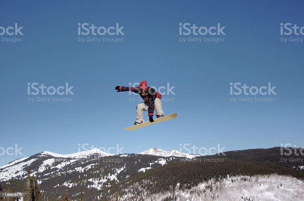 Snowboarder over the Rockies royalty-free stock photo