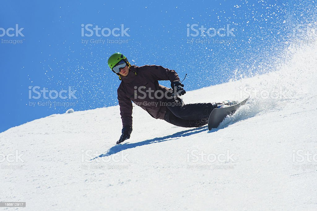 Snowboarder Performing Extreme Carving royalty-free stock photo