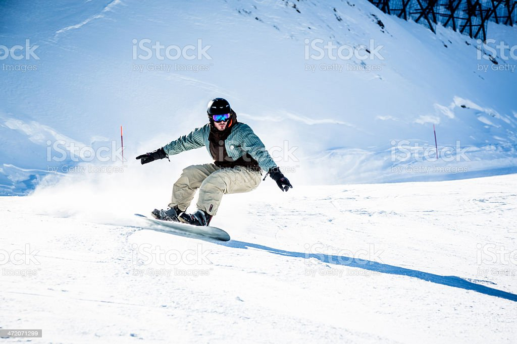 Young man snowboarding. Copy space.