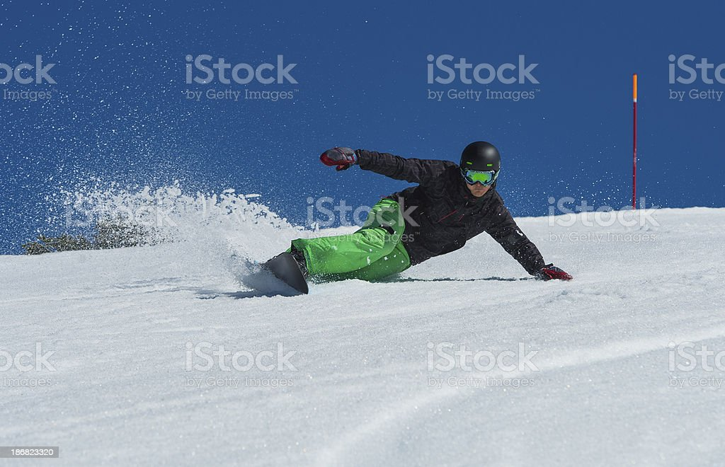 Snowboarder Practicing Extreme Carving stock photo