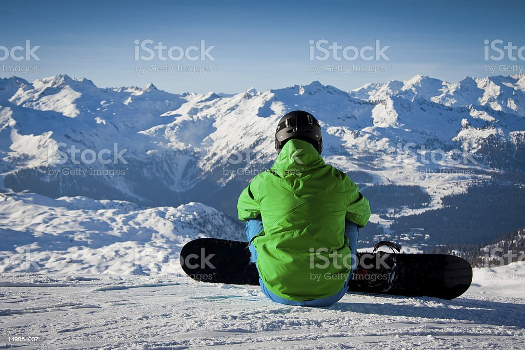 Snowboarder ready to go down stock photo