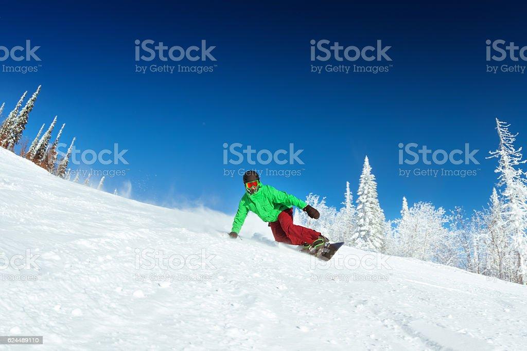 Snowboarder rides on slope snowboarding - foto de stock