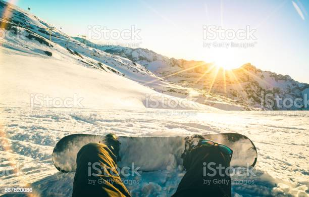 Snowboarder sitting at sunset on relax moment in french alps ski picture id867820086?b=1&k=6&m=867820086&s=612x612&h=kcodb99v dewwo6ssfwuekqtk w67mvkjolv6efrjwe=