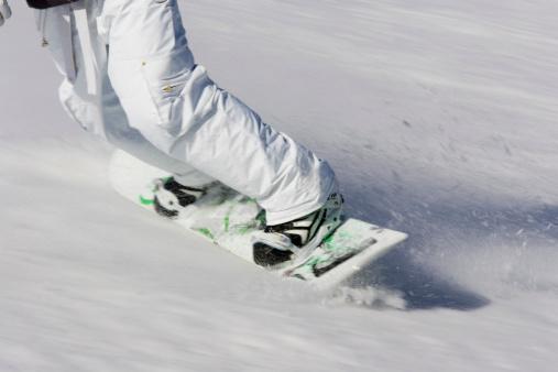Snowboarder slides down a slope