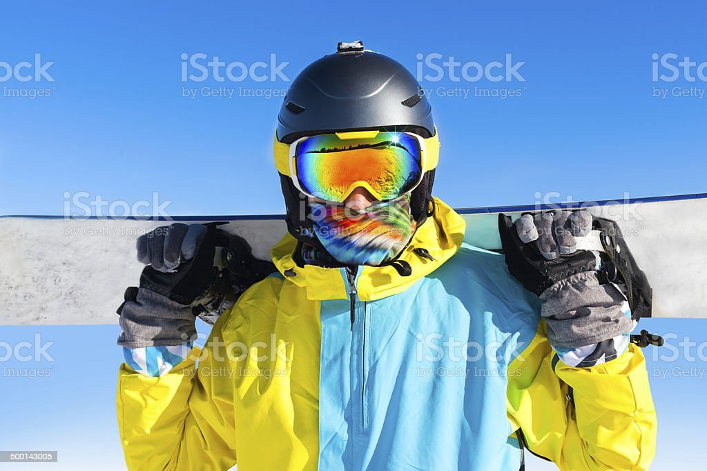 snowboarder standing on snow mountain slope stock photo