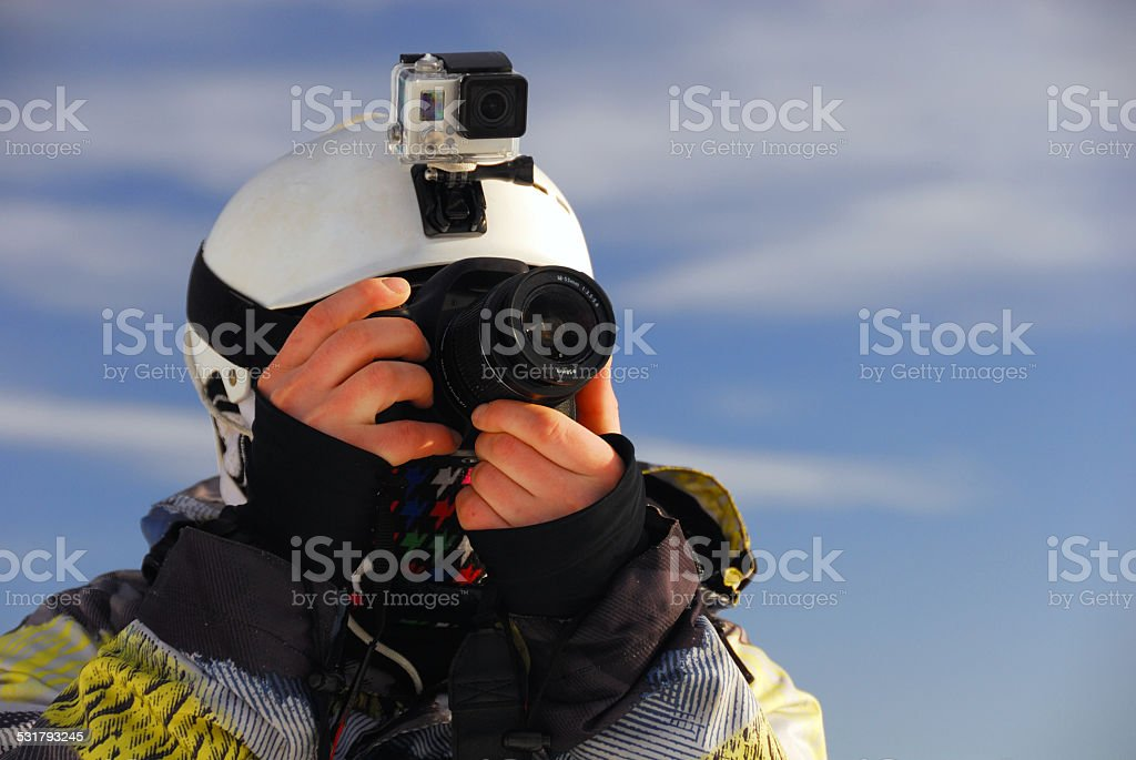 Snowboarder with camera stock photo