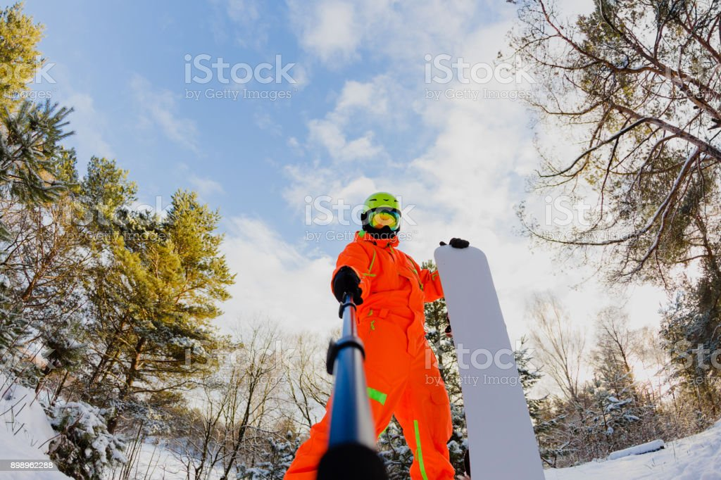 Snowboarder with the snowboard making a selfie stock photo