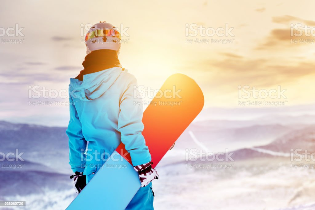 Snowboarder woman girl sunrise mountain top stock photo