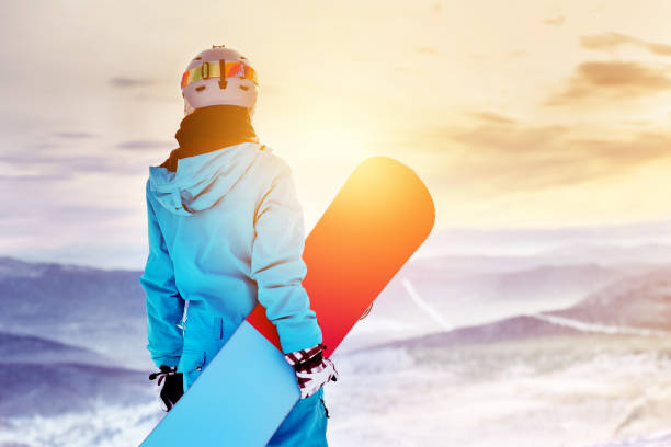 snowboarder woman girl sunrise mountain top - skidpist bildbanksfoton och bilder