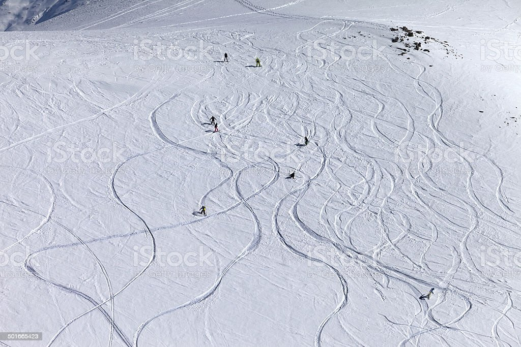 Snowboarders and skiers on off-piste slope at sun day royalty-free stock photo